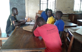Blind and visually impaired students in group revision session