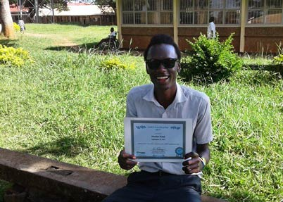 Ralph Musiime holds his 2017 Jaws- Certificate