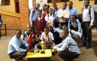 Students of Gulu High School and Negri College pose for a photo