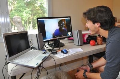 T.J. talks to student on Skype